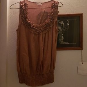 Sleeveless Ruffled top.  Size small peach color